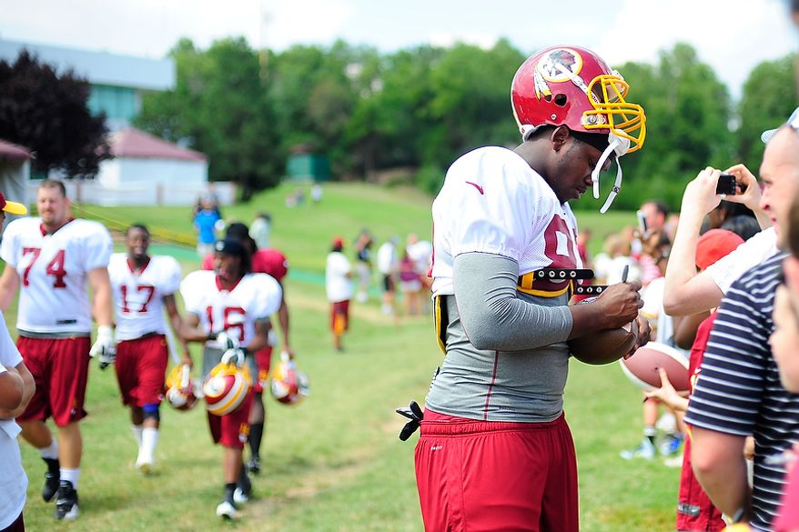 Beau Reliford signs autographs for fans during Redskins' training camp at Redskins Park, Ashburn, Va., Monday, July 30, 2012.  (Ryan M.L. Young/The Washington Times)