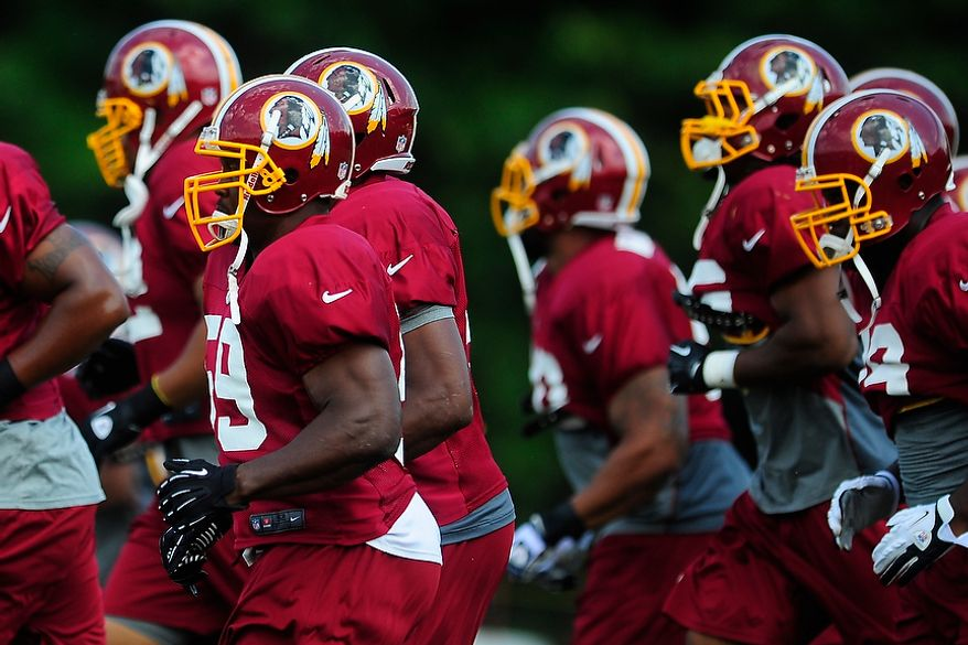 London Fletcher (#59) warms up during Redskins' training camp at Redskins Park, Ashburn, Va., Monday, July 30, 2012.  (Ryan M.L. Young/The Washington Times)