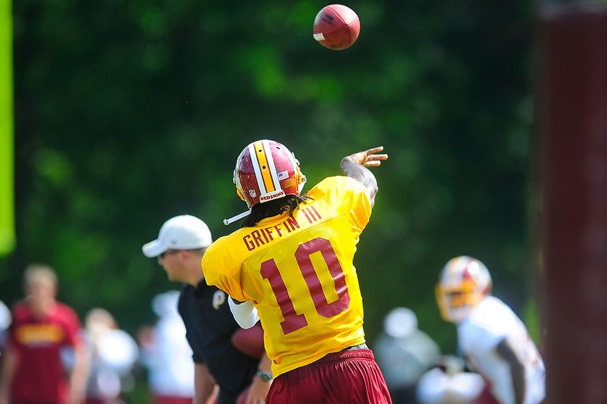 Robert Griffin III (#10) participates in drills during Redskins' training camp at Redskins Park, Ashburn, Va., Monday, July 30, 2012.  (Ryan M.L. Young/The Washington Times)
