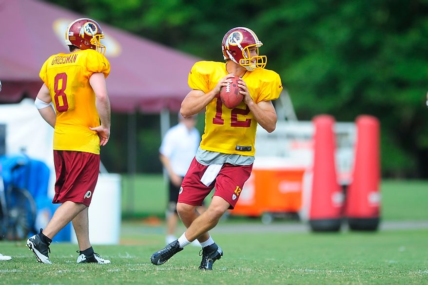Kirk Cousins (#12) participates in drills during Redskins' training camp at Redskins Park, Ashburn, Va., Monday, July 30, 2012.  (Ryan M.L. Young/The Washington Times)