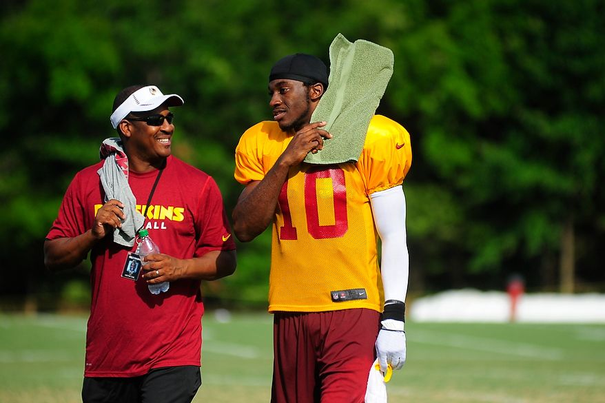 Robert Griffin III walks off the field following afternoon workouts at Redskins' training camp at Redskins Park, Ashburn, Va., Monday, July 30, 2012.  (Ryan M.L. Young/The Washington Times)