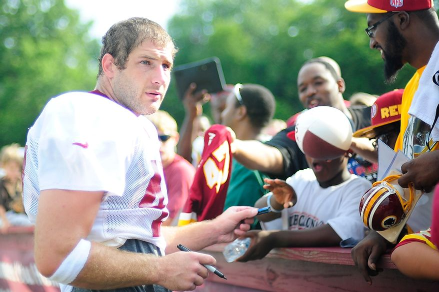 Chris Cooley signs autographs for fans following afternoon workouts at the Washington Redskins' training camp at Redskins Park in Ashburn, Va., on Monday, July 30, 2012. (The Washington Times)