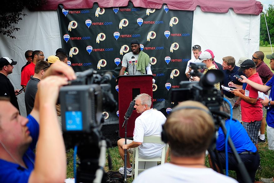 Robert Griffin III speaks to members of the media following Redskins' training camp at Redskins Park, Ashburn, Va., Monday, July 30, 2012.  (Ryan M.L. Young/The Washington Times)