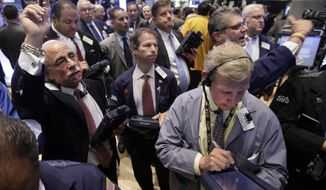 Traders work on the floor of the New York Stock Exchange on July 31, 2012. (Associated Press)
