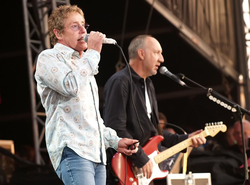 ** FILE ** In this July 2, 2006, file photo, Roger Daltrey, left, and Pete Townshend of The Who perform at the Hyde Park music festival, London, July 19, 2012. (AP Photo/ Max Nash)