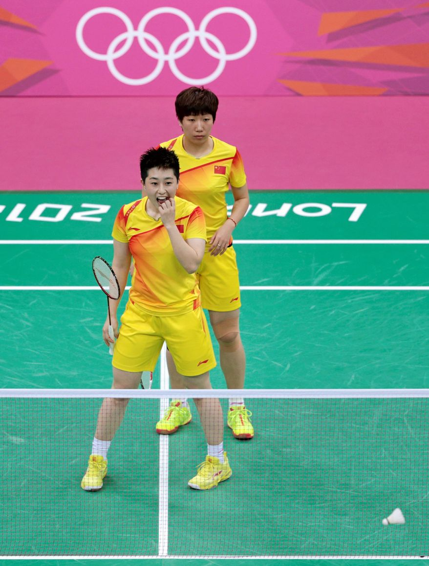 World doubles champions Yu Yang (left) and Wang Xiaoli of China were among eight badminton players dismissed from the games for intentionally trying to lose matches. (Associated Press)