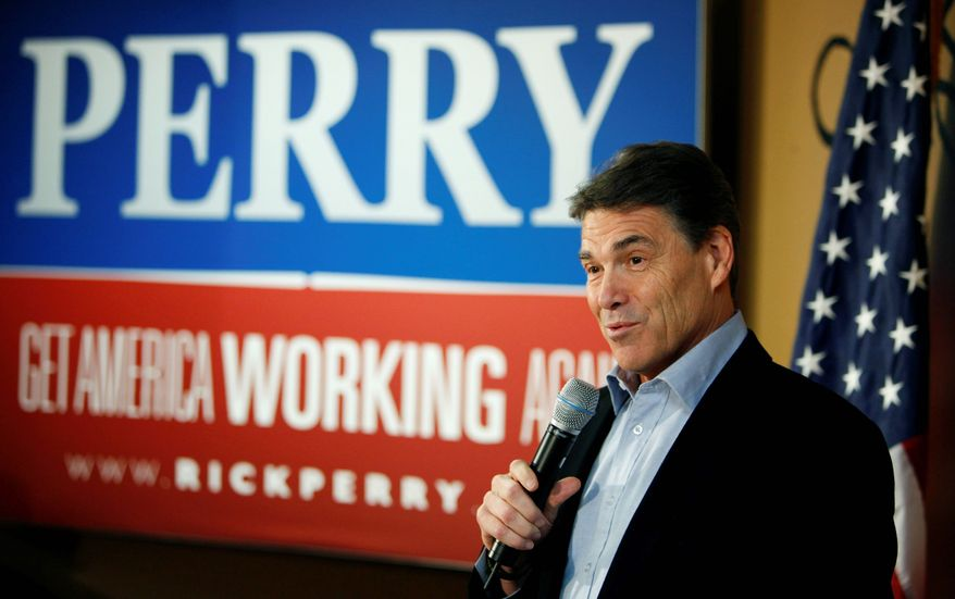 Republican presidential hopeful, Texas Gov. Rick Perry, speaks to local residents during a campaign stop at the Pizza Ranch restaurant, Monday, Dec. 19, 2011, in Manchester, Iowa. (AP Photo/Charlie Neibergall)