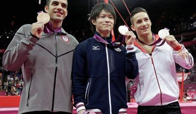associated press Gymnasts (from left) Danell Leyva, Kohei Uchimura and Marcel Nguyen show off their all-around medals Wednesday. Leyva, a Cuban immigrant competing for the United States, rallied to land the bronze.