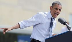 President Obama told a crowd Wednesday in Mansfield, Ohio, that the tax cut Republican Mitt Romney proposes would come at the expense of the middle class. (Associated Press)