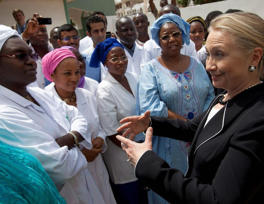 Secretary of State Hillary Rodham Clinton meets with local women during a tour of the Philippe Senghor Health Center in Dakar, Senegal, on Wednesday.