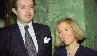 **FILE** Eva Rausing (right) and husband Hans Kristian Rausing attend Nov. 26, 1996, the Glamour America Fashion Show and lunch at Winfield House, London, the residence of the U.S. ambassador to the U.K. (Associated Press/Alan Davidson/The Picture Library Ltd)
