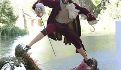 "This Nov. 3, 2011 photo released by Disney on Aug. 1, 2012 shows British actor Russell Brand dressed as Captain Hook from ""Peter Pan"" during a photo shoot with photographer Annie Leibovitz for the Disney Dream Portrait series near Newhall, Calif. The portrait series features celebrities set in Disney fantasy settings. (AP Photo/Disney Parks.com, Scott Brinegar)"