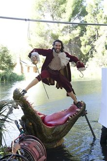 """This Nov. 3, 2011 photo released by Disney on Aug. 1, 2012 shows British actor Russell Brand dressed as Captain Hook from """"Peter Pan"""" during a photo shoot with photographer Annie Leibovitz for the Disney Dream Portrait series near Newhall, Calif. The portrait series features celebrities set in Disney fantasy settings. (AP Photo/Disney Parks.com, Scott Brinegar)"""