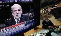 ** FILE ** Federal Reserve Chairman Ben Bernanke's testimony before Congress is shown on a television screen on the trading floor of the New York Stock Exchange, Tuesday, July 17, 2012. (AP Photo/Richard Drew)