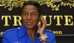 """** FILE ** In this Sept. 11, 2009 photo, Jermaine Jackson, brother of late U.S. """"King of Pop"""" Michael Jackson, is seen during a news conference in Vienna, Austria. Jermaine Jackson said, Wednesday, August 1, 2012, that he regretted the recent public turmoil that has embroiled his family and called for them to work out their issues in private. (AP Photo/Ronald Zak, File)"""