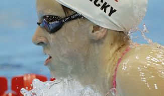 Katie Ledecky of the United States swims during a practice session at the Aquatics Center at the Olympic Park ahead of the 2012 Summer Olympics, Thursday, July 26, 2012, in London. Opening ceremonies for the 2012 London Olympics will be held Friday, July 27. (AP Photo/Matt Slocum)