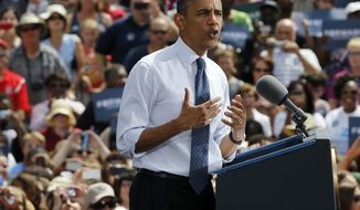 President Barack Obama speaks at a campaign event at Mansfield Central Park, Wednesday, Aug. 1, 2012, in Mansfield, Ohio. Obama is campaign in Ohio with stops in Mansfield and Akron today. (AP Photo/Pablo Martinez Monsivais)
