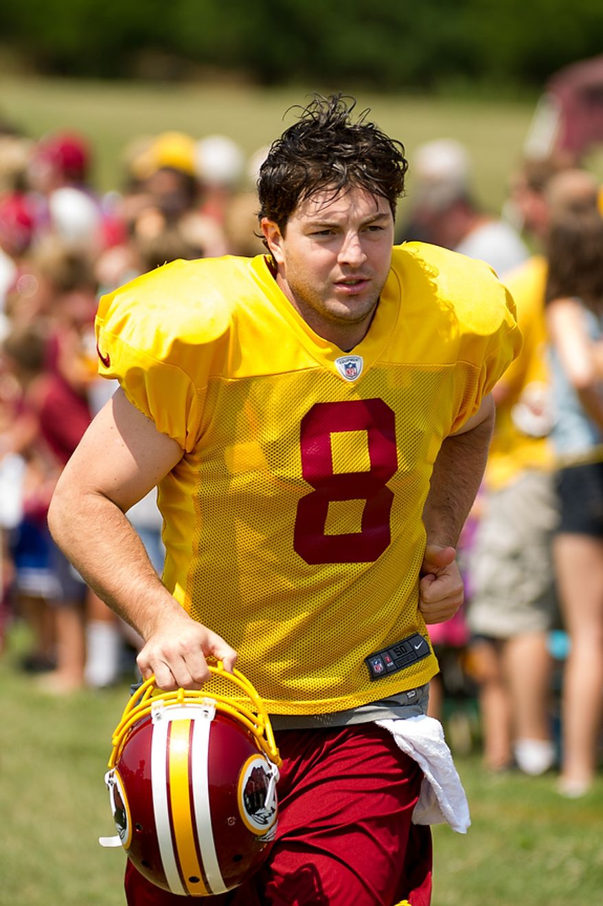 Washington Redskins quarterback Rex Grossman (8) makes his way to the field for afternoon practice at training camp at Redskins Park, Ashburn, Va., Wednesday, August 1, 2012. (Andrew Harnik/The Washington Times)