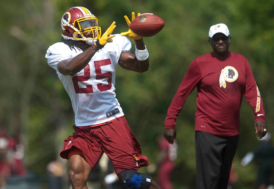 Washington Redskins running back Tim Hightower (25) completes a catch during training camp at Redskins Park on Wednesday, August 1, 2012, in Ashburn, Va. (Raymond Thompson/The Washington Times)
