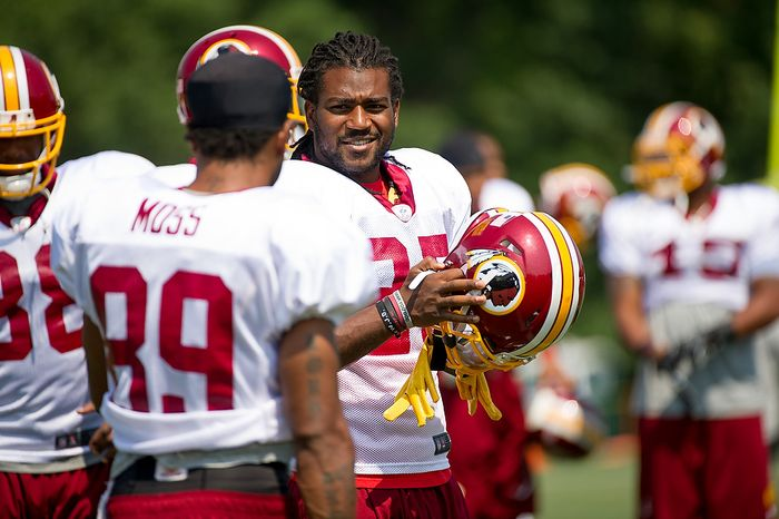 Washington Redskins running back Tim Hightower (25) talks with Washington Redskins wide receiver Santana Moss (89) at afternoon practice at training camp at Redskins Park, Ashburn, Va., Wednesday, August 1, 2012. (Andrew Harnik/The Washington Times)