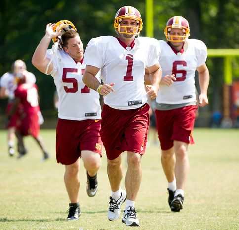 Left to right: Washington Redskins Nick Sundberg, Washington Redskins kicker Neil Rackers (1), and Washington Redskins punter Sav Rocca (6) jog on the field during afternoon practice at training camp at Redskins Park, Ashburn, Va., Wednesday, August 1, 2012. (Andrew Harnik/The Washington Times)