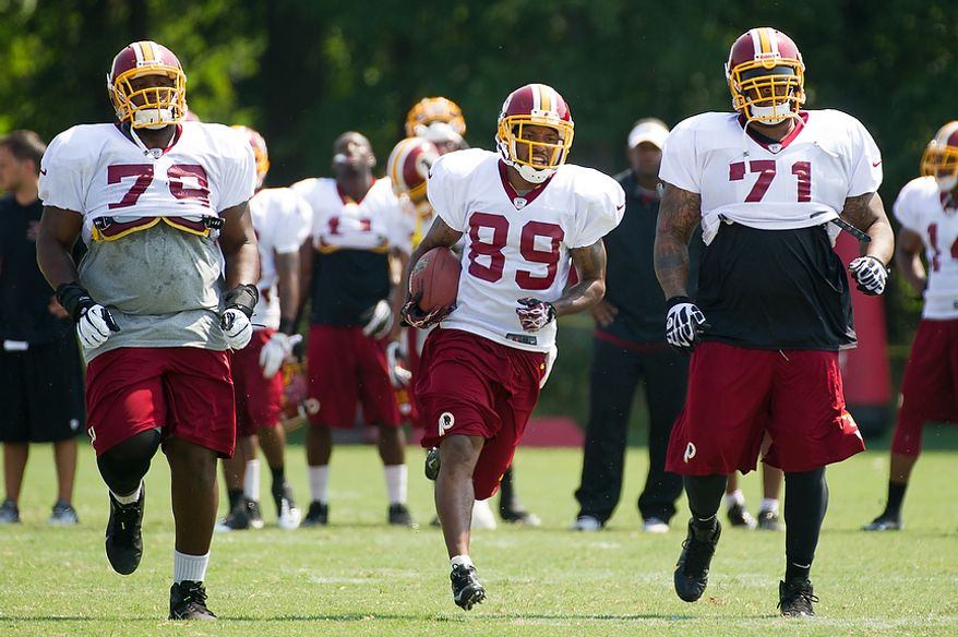 Washington Redskins wide receiver Santana Moss (89), center, during afternoon practice at training camp at Redskins Park, Ashburn, Va., Wednesday, August 1, 2012. (Andrew Harnik/The Washington Times)