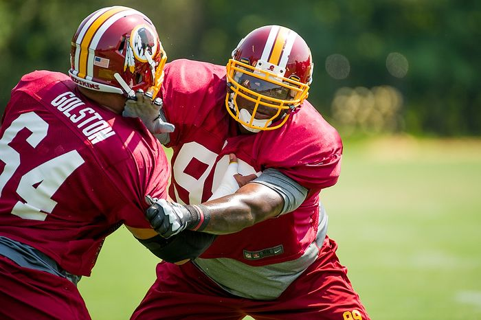 Washington Redskins defensive tackle Jarvis Jenkins (99), center, and Washington Redskins defensive tackle Kedric Golston (64), left, work out together during afternoon practice at training camp at Redskins Park, Ashburn, Va., Wednesday, August 1, 2012. (Andrew Harnik/The Washington Times)