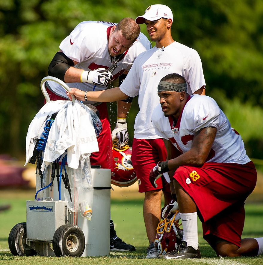 Washington Redskins offensive tackle Tyler Polumbus (74), left, and Washington Redskins tight end Fred Davis (83) take a break during afternoon practice at training camp at Redskins Park, Ashburn, Va., Wednesday, August 1, 2012. (Andrew Harnik/The Washington Times)