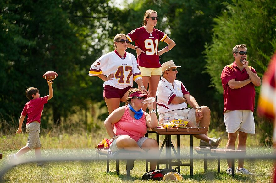 Washington Redskins fans enjoy themselves on the sidelines during afternoon practice at training camp at Redskins Park, Ashburn, Va., Wednesday, August 1, 2012. (Andrew Harnik/The Washington Times)