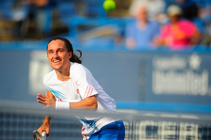 Alexandr Dolgopolov chases down a ball July 31, 2012, during his match against Flavio Cipolla at the Citi Open tennis tournament at the William H.G. FitzGerald Tennis Center in Washington, D.C. (Ryan M.L. Young/The Washington Times)