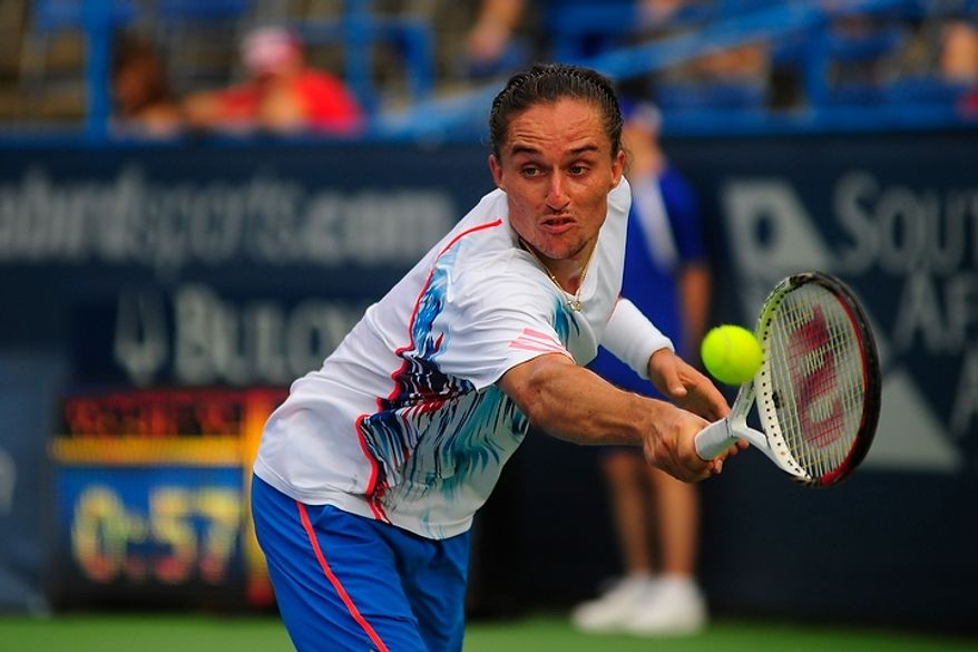Alexandr Dolgopolov hits a shot July 31, 2012, during his match against Flavio Cipolla at the Citi Open tennis tournament at the William H.G. FitzGerald Tennis Center in Washington, D.C. (Ryan M.L. Young/The Washington Times)