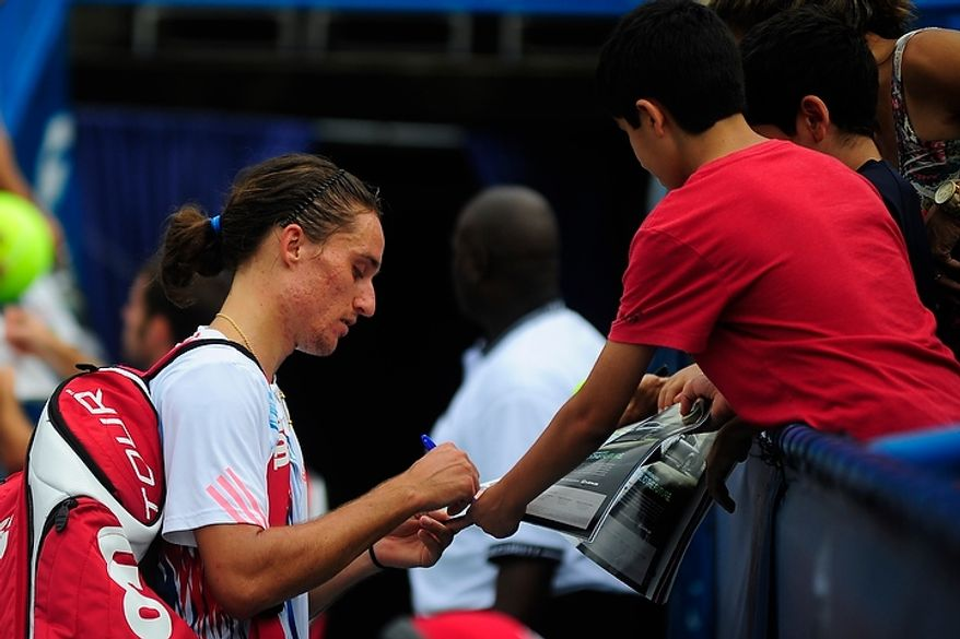 Alexandr Dolgopolov signs autographs July 31, 2012, after defeating Flavio Cipolla at the Citi Open tennis tournament at the William H.G. FitzGerald Tennis Center in Washington, D.C. (Ryan M.L. Young/The Washington Times)