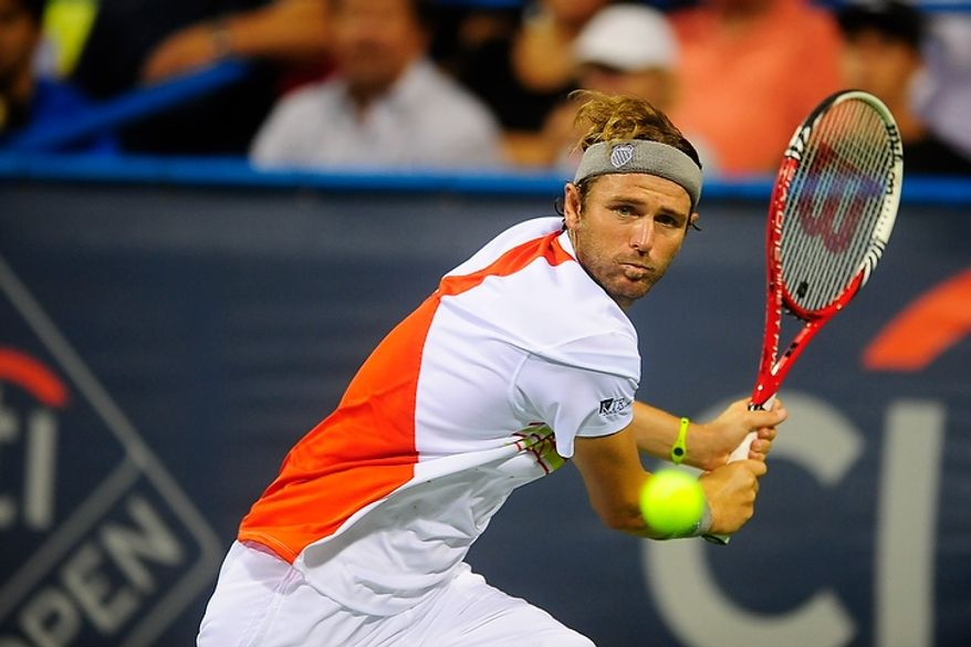 Mardy Fish hits a shot July 31, 2012, during his match against Bjorn Phau in the Citi Open tennis tournament at the William H.G. FitzGerald Tennis Center in Washington, D.C. (Ryan M.L. Young/The Washington Times)