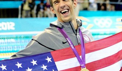 ASSOCIATED PRESS PHOTOGRAPHS  THE BEST: U.S. swimmer Michael Phelps, who has won the most Olympic medals in history, and Chinese weight-lifting gold medalist Wang Mingjuan rejoice in victory.