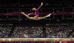 U.S. gymnast Gabrielle Douglas performs Aug. 2, 2012, on the balance beam during the artistic gymnastics women's individual all-around competition at the 2012 Summer Olympics in London. (Associated Press)
