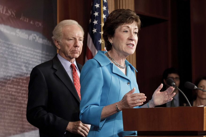 ** FILE ** Sen. Susan Collins, R-Maine, the ranking member of the Senate Homeland Security Committee, right, accompanied by the committee's Chairman Sen. Joseph Lieberman, I-Conn., gestures during a news conference on Capitol Hill in Washington, Tuesday, July 24, 2012. (AP Photo/J. Scott Applewhite)