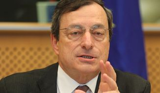 **FILE** President of the European Central Bank Mario Draghi reports May 31, 2012, to the Economic Committee, in capacity as the head of the European Systemic Risk Board, at the European Parliament in Brussels. (Associated Press)