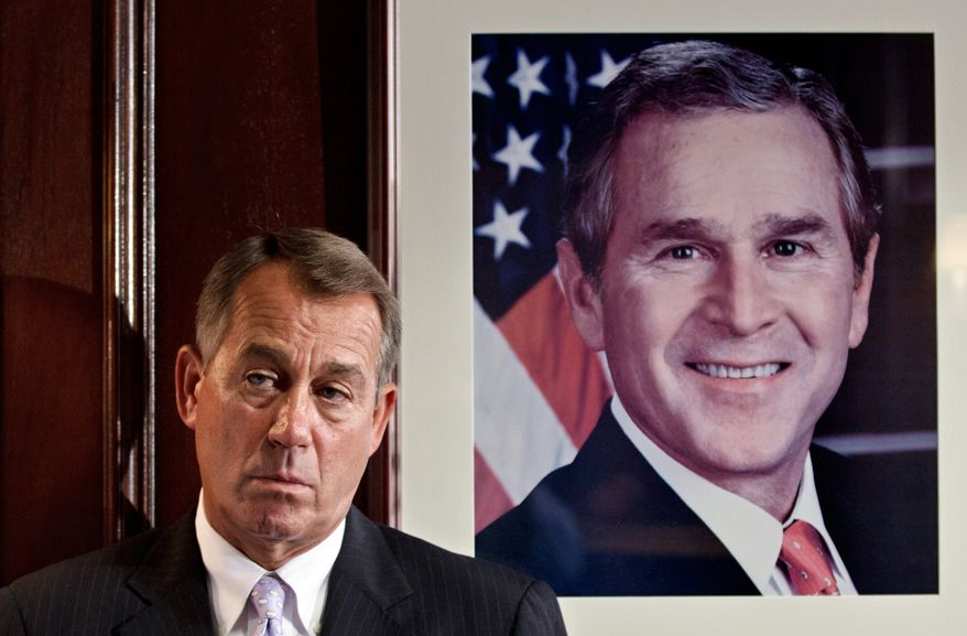 **FILE** Speaker of the House John Boehner, Ohio Republican, stands July 24, 2012, next to a portrait of former President George W. Bush as he waits to speaks with reporters following a House GOP caucus meeting on Capitol Hill in Washington. (Associated Press)