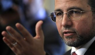 Egypt's new prime minister Hesham Kandil talks Aug. 2, 2012, during a press conference in Cairo. (Associated Press)