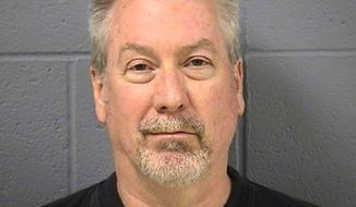 **FILE** Former Bolingbrook, Ill., police officer Drew Peterson is seen May 7, 2009, in a booking photo provided by the Will County Sheriff's Office in Joliet, Ill. (Associated Press/Will County Sheriff's Office)
