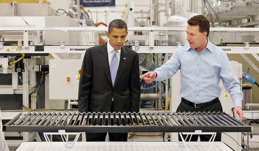 **FILE** President Obama, accompanied by Solyndra CEO Chris Gronet, looks at a solar panel during a May 26, 2010, tour of Solyndra Inc., a solar panel manufacturing facility, in Fremont, Calif. (Associated Press)