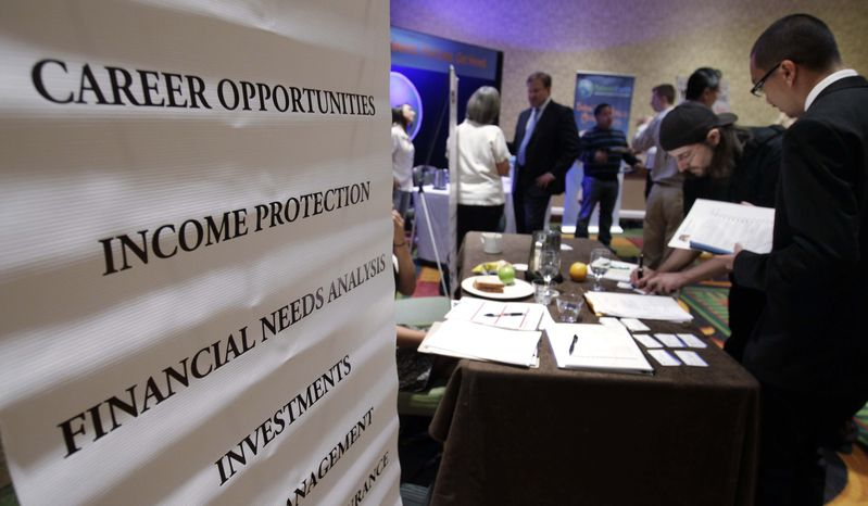 ** FILE ** In this July 25, 2012, file photo, people looking for work talk at a Primerica job booth at a job fair in San Jose, Calif. U.S. hiring was likely sluggish in July for a fourth straight mon