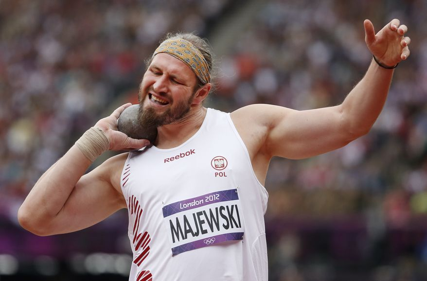 Poland's Tomasz Majewski makes an attempt in the qualification for the men's Shot Put during the athletics in the Olympic Stadium at the 2012 Summer Olympics, London, Friday, Aug. 3, 2012. (AP Photo/Matt Dunham)