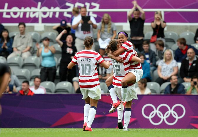United States' Sydney Leroux, right, celebrates her goal with her teammates during their women's quarter-final soccer match against New Zealand at St James' Park in Newcastle, England, during the London 2012 Summer Olympics, Friday, Aug. 3, 2012. (AP Photo/Scott Heppell)