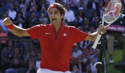 Roger Federer of Switzerland celebrates after defeating Juan Martin del Potro of Argentina at the All England Lawn Tennis Club in Wimbledon, London at the 2012 Summer Olympics, Friday, Aug. 3, 2012. (AP Photo/Elise Amendola)