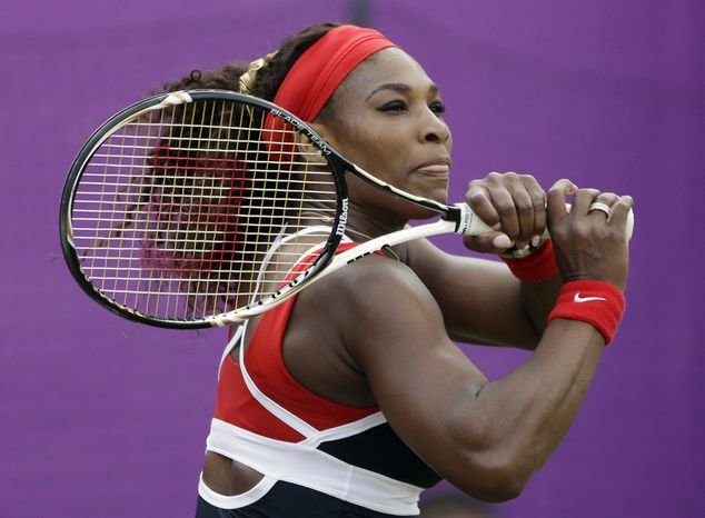Serena Williams of the United States returns a shot to Caroline Wozniacki of Denmark at the All England Lawn Tennis Club at Wimbledon, in London, at the 2012 Summer Olympics, Thursday, Aug. 2, 2012. (AP Photo/Mark Humphrey)