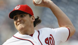 Washington Nationals starting pitcher John Lannan delivers in the first inning during the first baseball game of a doubleheader against the Miami Marlins, Friday, Aug. 3, 2012, in Washington. (AP Photo/Carolyn Kaster)