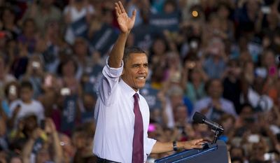 President Barack Obama greets the crowd after arriving for a campaign stop at Loudoun County High School on Thursday, Aug. 2, 2012, in Leesburg, Va. (AP Photo/Evan Vucci)