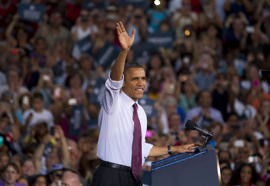 President Obama greets the crowd after arriving for a campaign stop at Loudoun County High School on Thursday, Aug. 2, 2012, in Leesburg, Va. (AP Photo/Evan Vucci)