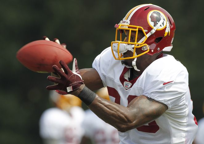 Washington Redskins tight end Fred Davis catches a pass during an NFL football training camp practice at Redskins Park, Friday, Aug. 3, 2012 in Ashburn, Va. (AP Photo/Alex Brandon)